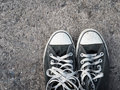 Old sneaker with street background Royalty Free Stock Photos