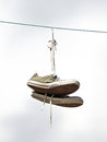 Old sneakers hanging from a powerwire Royalty Free Stock Photo