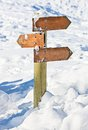 Old snow covered wooden signpost Stock Images