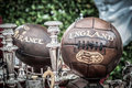 Old soccer rugby balls Royalty Free Stock Photo