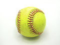 An old softball over white background Stock Photography