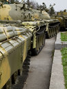 Old soviet tank in column Stock Photography