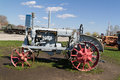 Old soviet tractor with metal wheels tolyatti russia april vintage Stock Photo