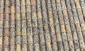 Old Spanish roof tiles. Beige and yellow texture. Royalty Free Stock Photo