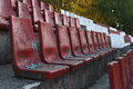 Old stadium chairs rows of red and white color seats in the Royalty Free Stock Photography