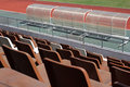 Old stadium seats in sunlight Royalty Free Stock Image
