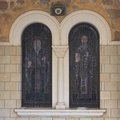Old stained glass church closeup vertical outdoors Royalty Free Stock Photo