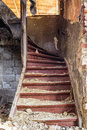 The old stairs staircase in an abandoned house that has been after earthquake Royalty Free Stock Photo