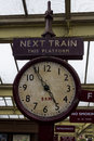 Old station clock on platform of Keighley Station, Worth Valley Railway. Yorkshire, England, UK, Royalty Free Stock Photo