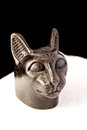 Old Statue Of Cat Head On Black And White Background