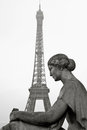 Old statue with eiffel tower in the background in paris france classic romantic view Stock Image