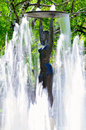Old statue in the park of the town of hissar in bulgaria photo fountain with a a woman surrounded by water jets Stock Photo