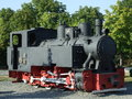 Old steam locomotive exposed in tineretului park in bucharest romania Royalty Free Stock Photo