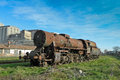 Old steam locomotive large which for years waiting for repair and museum Royalty Free Stock Photo