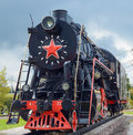 Old steam locomotive from the soviet union on rails Royalty Free Stock Photos