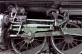 Old steam locomotive wheel and rods Royalty Free Stock Photo