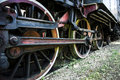 Old steam locomotive wheels exhibiting at da lat city vietnam Royalty Free Stock Image