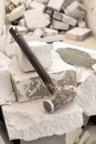 Old steel hammer smashing on broken brick wall Royalty Free Stock Photo