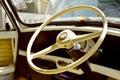 Old steering wheel interior in vintage automobile Stock Photo