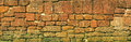 Old stone block wall. Thailand, Ayutthaya. Panoramic photo Royalty Free Stock Photo