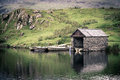 Old stone boathouse lake snowdonia north wales nostalgic effect intentional vignetting Stock Photos
