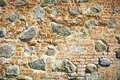 Old stone and brick wall of castle. Royalty Free Stock Photo
