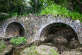 Old stone bridge in the jungle Royalty Free Stock Photo