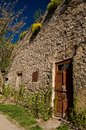 An old stone building with weeds on the roof Royalty Free Stock Photo