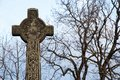 Old Stone Celtic Cross Against a Clear Winter Sky Royalty Free Stock Photo