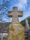 Old stone cross in the woods.