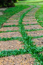 Old stone footpath on green grass picture of laterite Stock Photography