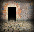 Old stone house door entrance to way to darkness Stock Image