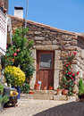 Old stone house with door and flowers Royalty Free Stock Photos
