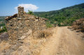 Old stone house in traditional turkish village with dirt road Royalty Free Stock Photo
