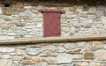 Old stone house wall and window Royalty Free Stock Images