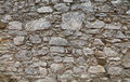 Old stone layered wall of fortress or castle Royalty Free Stock Photo
