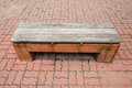 Old stone park bench by side a road Royalty Free Stock Image