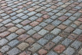Old stone paved avenue street road low angle Stock Image