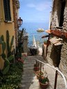 Old stairs going down to the sea in Scilla Royalty Free Stock Photo