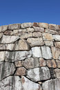 Old stone wall against blue sky clear close up Royalty Free Stock Image