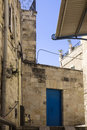 The old stone wall and the blue door in a street of the old town Royalty Free Stock Photo