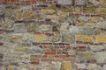 Old stone wall with bricks and cement background Royalty Free Stock Image