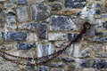 Old stone wall with hook and chains Royalty Free Stock Photo