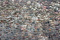 Old stone wall the photograph shows a fragment of an made ​​of stones Royalty Free Stock Photography