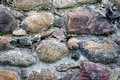 Old stone wall the photograph shows a fragment of an made ​​of stones Royalty Free Stock Photos