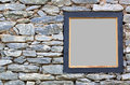 Old stone wall with a wood frame Royalty Free Stock Photo