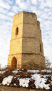 Old stone water tower in winter light brick historic with snow Royalty Free Stock Image