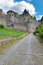 Old stony street leading to la cite medievale carcassonne in france Royalty Free Stock Image
