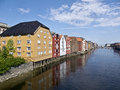 Old storehouses in trondheim in norway on a canal Royalty Free Stock Photo