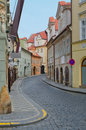 Old street with colorful houses, Prague Stock Photo
